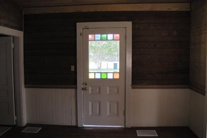 Front Entry Door and East Wall of Entryway