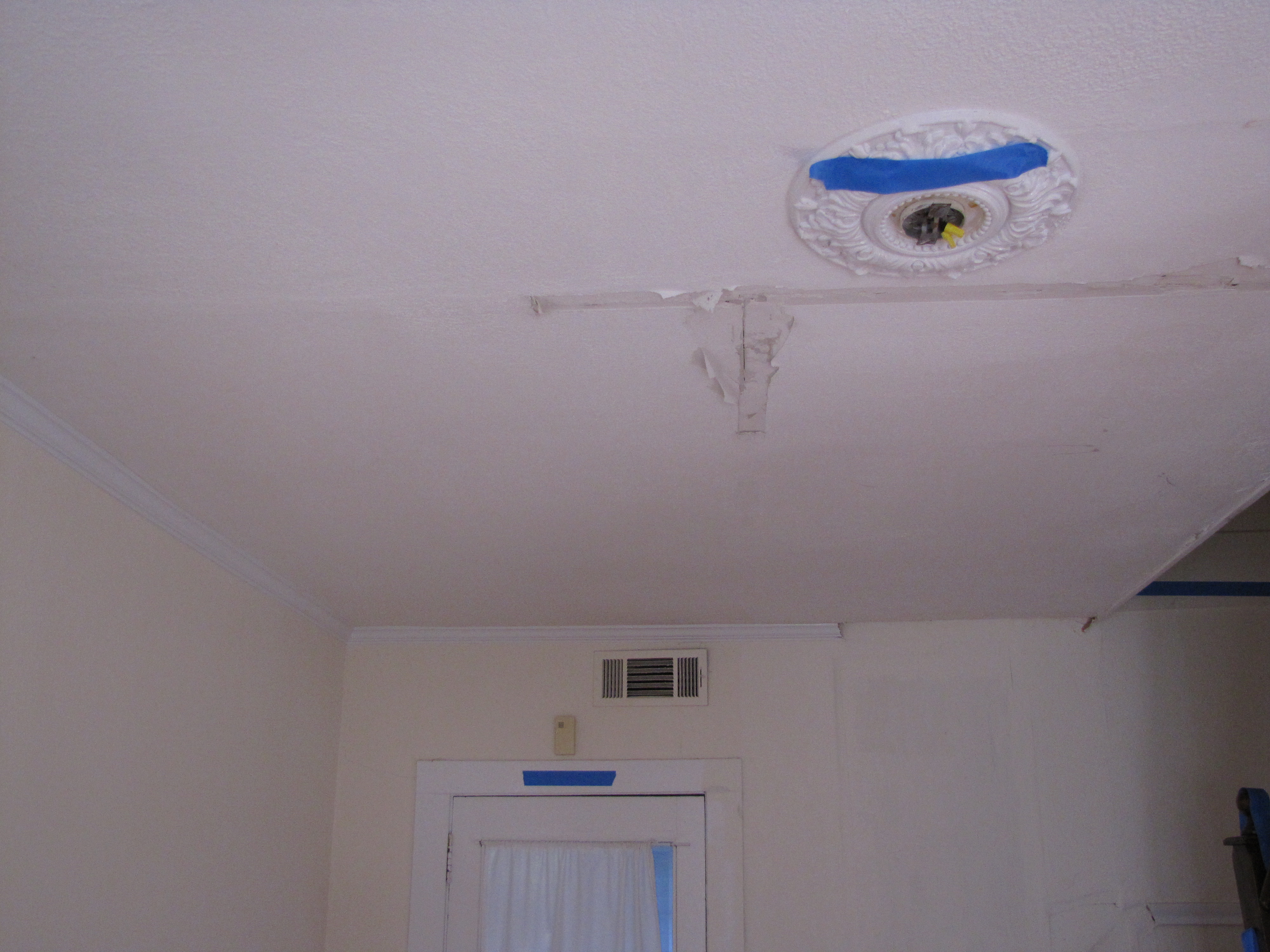Ceiling and Missing Light Fixture of Entryway, Fac
